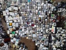 航拍电子废品回收站 空调彩电堆积如积木